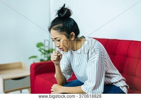 Asian Woman Coughing With Sore Throat,women Suffering With Cough A Lot At Home