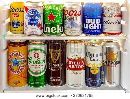 Calgary, Alberta, Canada. Jun 9 2020. A Beer Fridge With World Famous Beer Brands On A Mini Fridge.