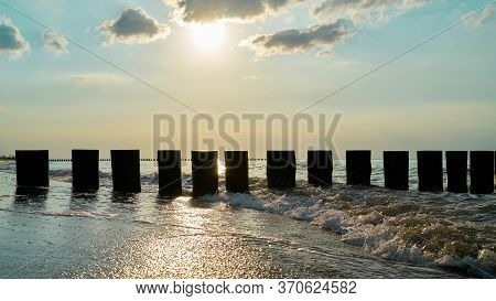 Breakwater On The Beach Of The Polish Baltic Sea Near Rewal In Backlight