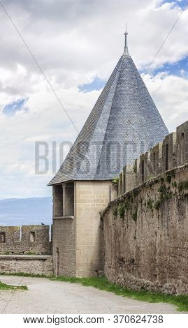 Battlement Fortress Wall With The Tower Against The Sky