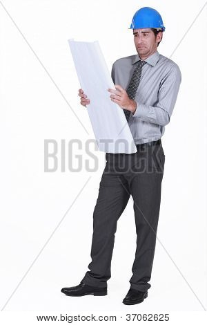 Scared architect looking at plans