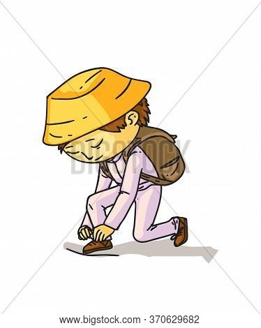Little Asian Boy In Traditional Clothes Tying Shoelaces Isolated On White. Schoolboy Dressing Up Him