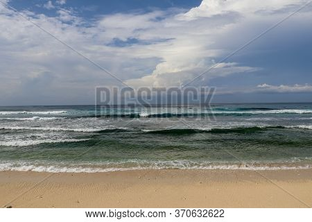 Surfers Are Waiting For A Convenient Wave On Their Surfboards. Tropical Surfers Paradise With Nyang