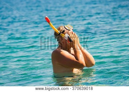 Man With Snorkeling Tube In Sea