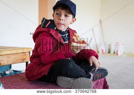 boy eating a slice of pizza