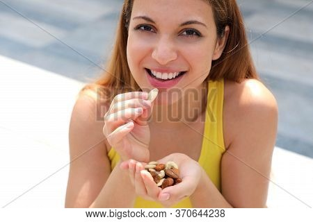 Close Up Fitness Girl Eating Healthy Mix Of Nuts Seeds Dried Fruit Outdoor