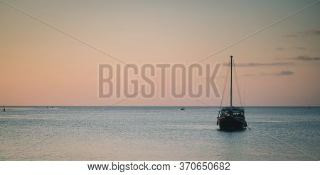 View Of Boat With Sunset Light Take Photo From Phangan Island, Thailand.ad Noise And Split Color.