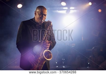Saxophone player on stage portrait
