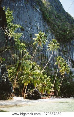 El Nido, Palawan, Philippines. Secluded Tropical Hut Under Palm Trees On Pinagbuyutan Island