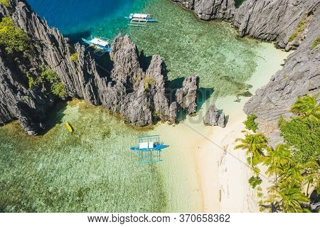 El Nido, Palawan, Philippines, Aerial View Of Boats And Karst Scenery At Secret Lagoon Beach