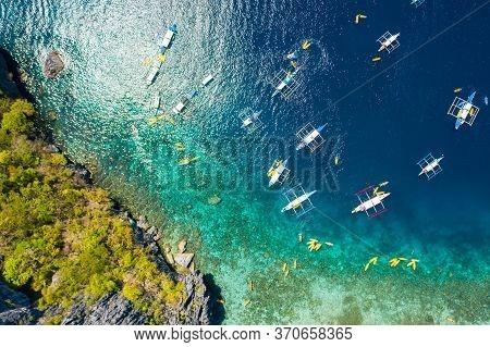 Top Down View Of Tourist Boats Close To Big Lagoon, Aerial View. Tropical Landscape. El Nido, Palawa