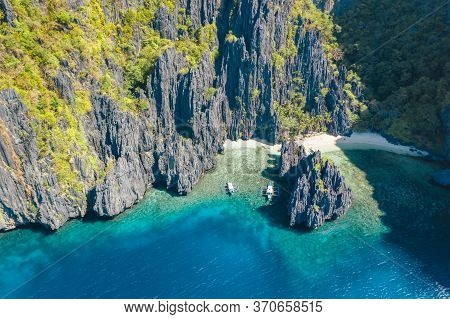 El Nido, Palawan, Philippines, Aerial View Of Boats And Rocky Mountains Scenery At Secret Lagoon Bea