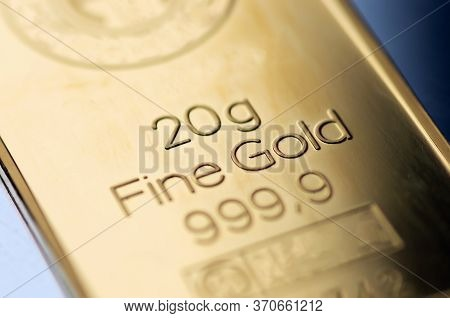 The Surface Of A Minted Gold Bar Weighing 20 Grams. Selective Focus.