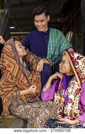 A Group Of Malaysian People Wearing Traditional Cloth