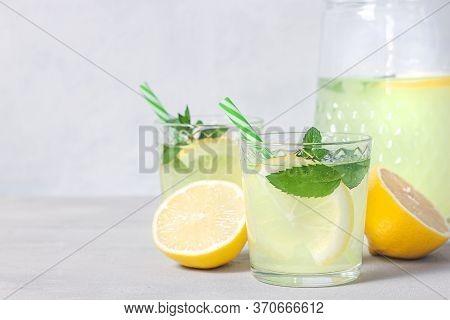 Lemon Lemonade With Herb On Grey Background. Summer Drink. Traditional Lemonade With Lemon Mint And