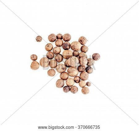 Small Pile Of Black Pepper Isolated On White Background. Top View. (dried Seeds Of Piper Nigrum). Pe