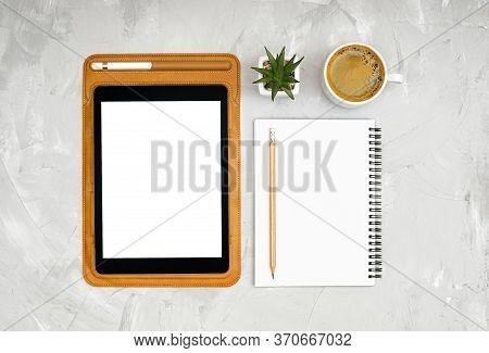 Tablet Computer With A Leather Sleeve, Spiral Notebook, Pencil, Stylus Pen, Small Desk Flower And A