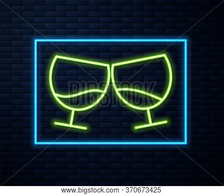 Glowing Neon Line Glass Of Cognac Or Brandy Icon Isolated On Brick Wall Background. Vector