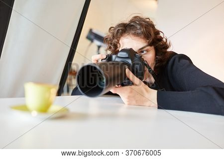 Professional photographer photographs a cup for advertising photography