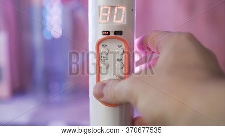 Close Up Of A Hand Turning Remote Controller Of Led Illumination In The Room. Stock Footage. Color O