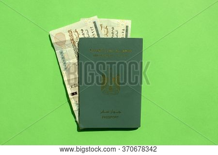Arab Republic Of Egypt Passport With Egyptian Currency Pound Isolated On Green Background. Egyptian
