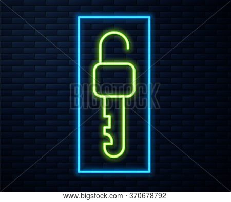 Glowing Neon Line Unlocked Key Icon Isolated On Brick Wall Background. Vector