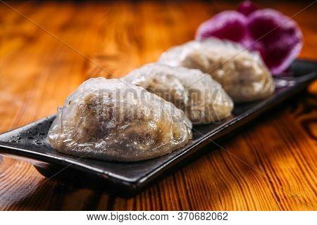 Closeup On Korean Patties Starchy Pyan-se Pygody On The Wooden Table, Horizontal