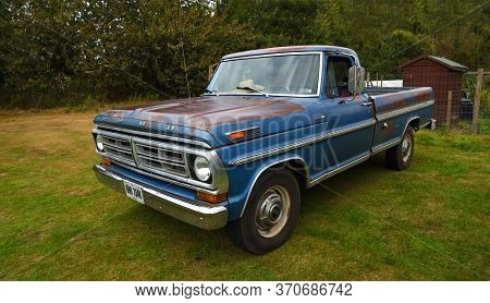 Upper Dean, Bedfordshire, England - September 07, 2019:  Classic Blue Ford F 250 Pickup Parked Isola