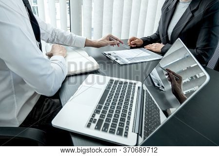 Business People Hold A Job Profile And Talk To Job Applicants For Job Interviews About Careers And B