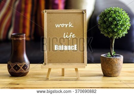 Image Of Motivational Greeting Work Life Balance On Brown Mini Notice Board. Besides A Decorative Gr