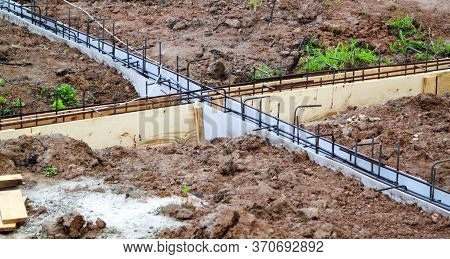 Reinforcement Of Concrete With Metal Rods Connected By Wire And Wooden Formwork. Preparation For Pou