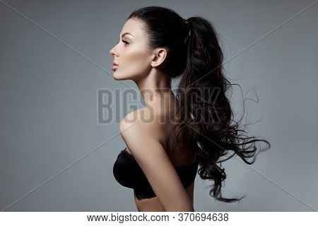 Sexy Fashion Woman With Long Hair, Curly Strong Hair Of A Brunette Girl In Lingerie. Natural Cosmeti