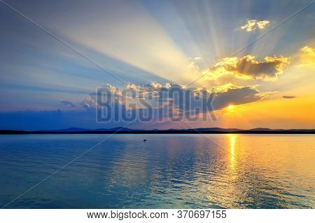 Summer landscape, sunset sea nature. Summer sea landscape scene. Sea sunset landscape. Summer sunny water scene in picturesque tones. Sea summer nature with mountains at the horizon - panoramic sea view