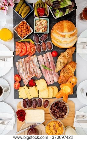 Breakfast On The Table. Croissant Bread, Croissant Cereal, Bacon, Ham, Cheese, Lettuce, Beans, Corn
