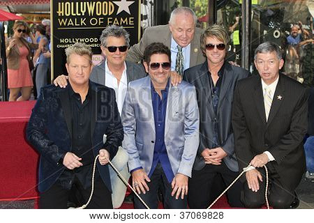 LOS ANGELES - SEP 17: Gary LeVox, David Foster, Jay DeMarcus, JoeDon Rooney, Leron Gubler at a ceremony as the band Rascal Flatts get a star on the Walk of Fame on September 17, 2012 in Los Angeles,CA