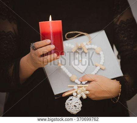 A Picture Of A Woman Holding A Candle To Perform Magic Rituals And Mysteries About Superstition In T