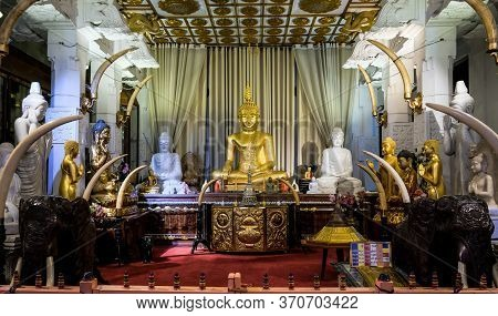 Kandy / Sri Lanka - 2019: Altar With Golden And White Buddha Statues In The Temple Of The Sacred Too