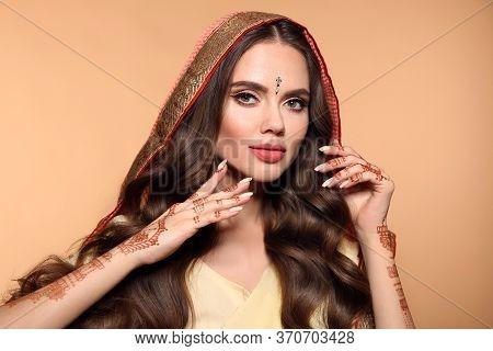 Mehndi. Portrait Of Beautiful Girl In Saree Isolated On Beige. Young Hindu Woman Model With Kundan G