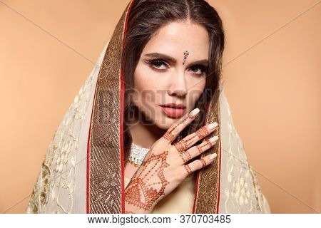Mehendi. Portrait Of Beautiful Indian Girl In Saree Isolated On Beige. Young Hindu Woman Model With