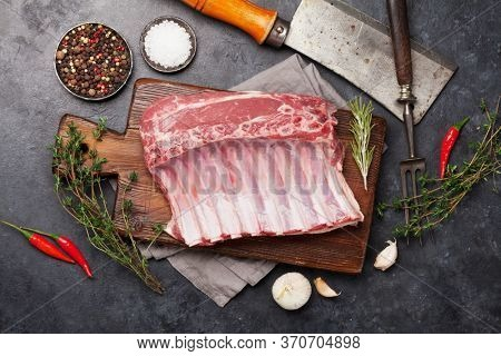 Lamb ribs cooking. Raw rack of lamb with spices and condiments. Top view
