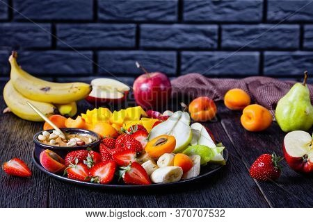 Fruit Mix With Peanut Butter Dip: Strawberries, Tropical Mango, Banana, Apples, Pears, Apricots, And