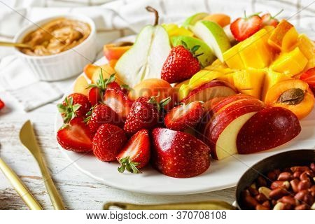 Holiday Colorful Fruit Platter Of Strawberries, Mango, Apples, Pears, Apricots, With Peanut Butter A