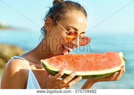 Summer Portrait Funny Girl In Red Glasses Holding Huge Slice Of Watermelon And Bites Him With Pleasu