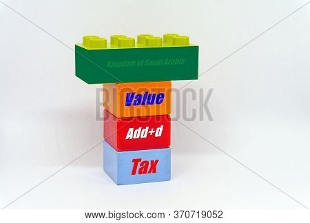 Conceptual Of Value-added Tax Roll-out In Saudi Arabia. Stacked Colorful Plastic Bricks With Texts V