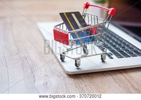 Shopping Cart And Credit Card On Laptop At Home Office. Business, E-business, Technology, E-commerce