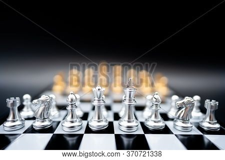 The Battle Chess Sport Game Stand On Chess Board With Dark Background.business Leader Concept For Ma