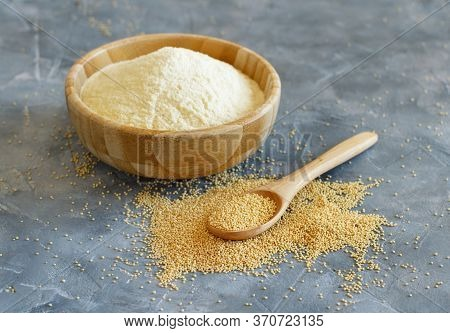 Bowl Of Raw Amaranth Flour With A Spoon Of Amaranth Seeds Close Up