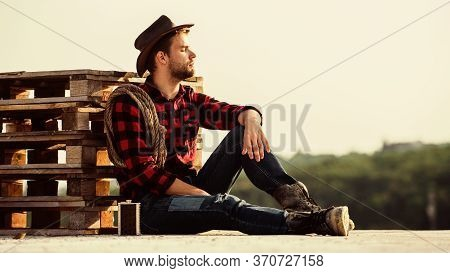 Ride Away. Western Cowboy Portrait. Wild West Rodeo. Thoughtful Man In Hat Drink Whiskey. Cowboy Wit