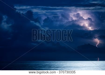 Massive Cumulus Clouds And Lightning At Night Over The Black Sea In Crimea