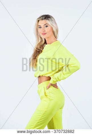 Posing For Photo. Training Outfit For Workout In Fitness Center. Fashion Portrait Of Athletic Girl.